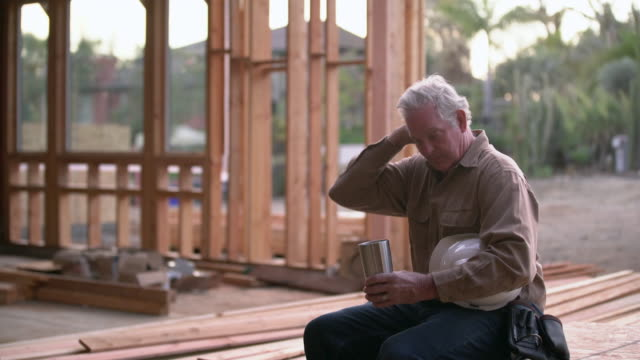 MS Mature man taking a break at a building site