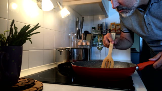 mature man tasting food that he has prepared - smelling stock videos & royalty-free footage