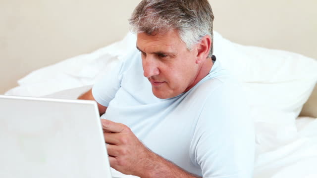 mature man using a laptop - only mature men stock videos and b-roll footage