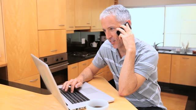 Mature man using his mobile phone