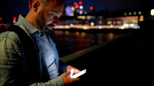 Mature man using phone in London