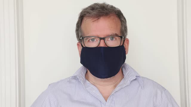 mature man video portrait putting on a protective mask - condensation stock videos & royalty-free footage