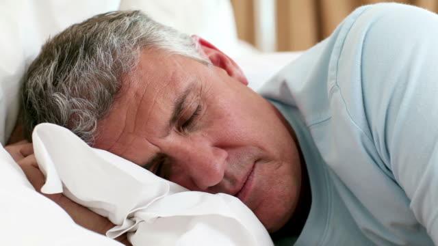 Mature man waking up