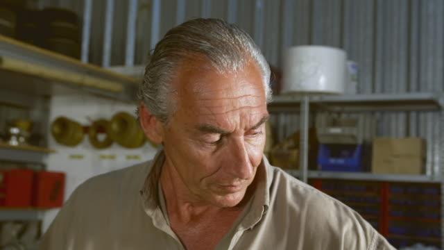 cu mature man working at workshop / near torre del mar, malaga, spain - sweat stock videos & royalty-free footage