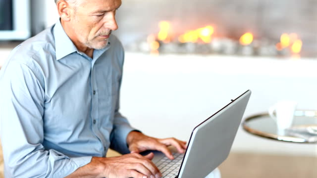A mature man working from the comfort of his home - Copyspace
