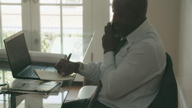 CU Mature man working in home office