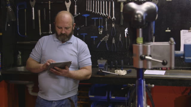 mature man working in workshop - 40 seconds or greater stock-videos und b-roll-filmmaterial