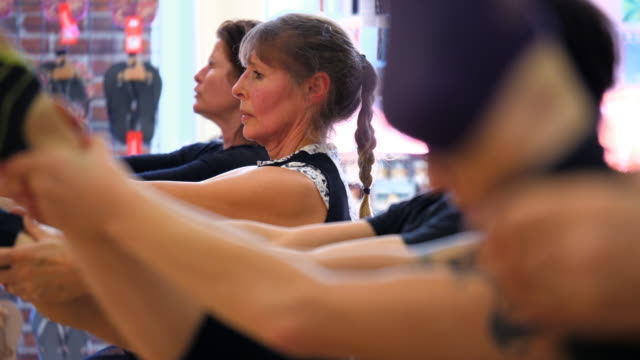 ms mature men and women working out during pilates class in fitness studio - trousers stock videos & royalty-free footage