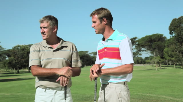 mature men chatting on golf course - golfer stock videos and b-roll footage