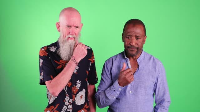 mature men contemplating - suspicion stock videos & royalty-free footage