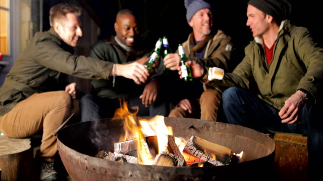 Mature Men Enjoying an Evening by the Fire
