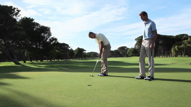 mature men playing golf on golf course - punching the air stock videos & royalty-free footage