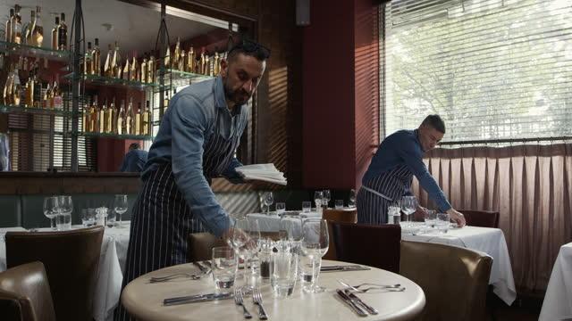 mature men preparing restaurant tables - 45 49 years stock videos & royalty-free footage