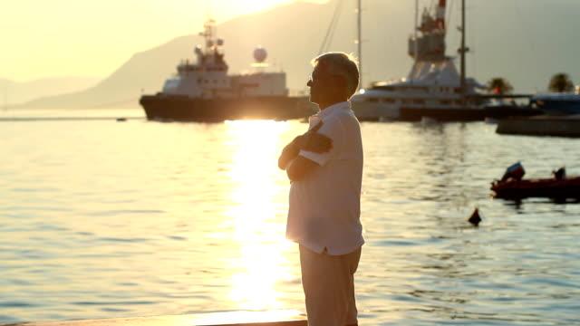 Mature men standing in a Harbor