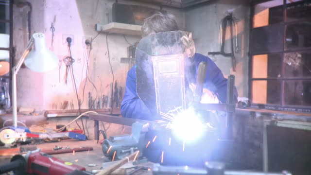 hd dolly: mature men welding in workshop - after work stock videos & royalty-free footage