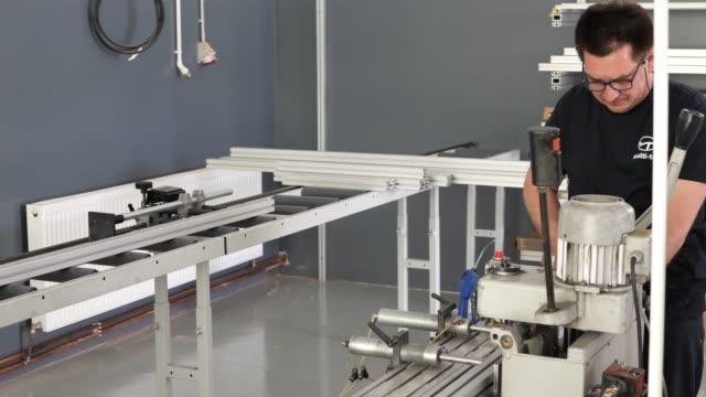 mature metal industry employee working on the drill. - mascolinità video stock e b–roll