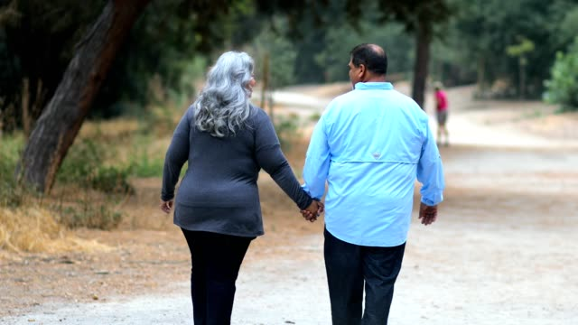mature mexican couple walking on a path - mexican ethnicity stock videos & royalty-free footage
