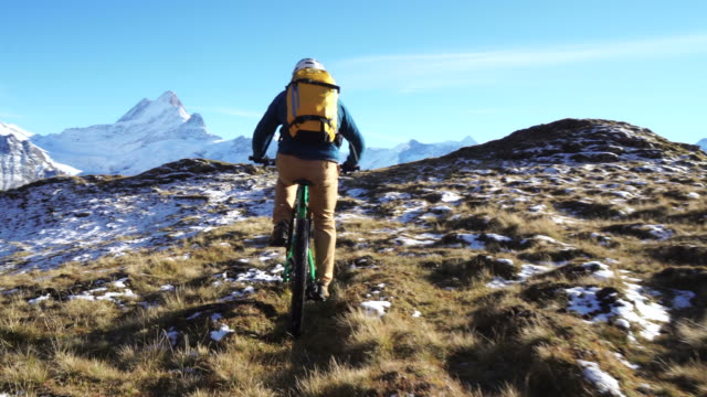 mature mountain biker approaches summit on mountain bike - mountain bike stock videos & royalty-free footage