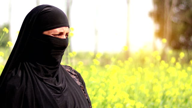 mature muslim female standing in the nature - mature adult stock videos & royalty-free footage