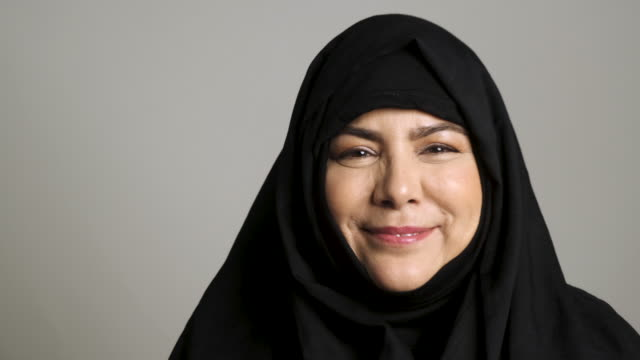 mature muslim woman looking at the camera - islam stock videos & royalty-free footage