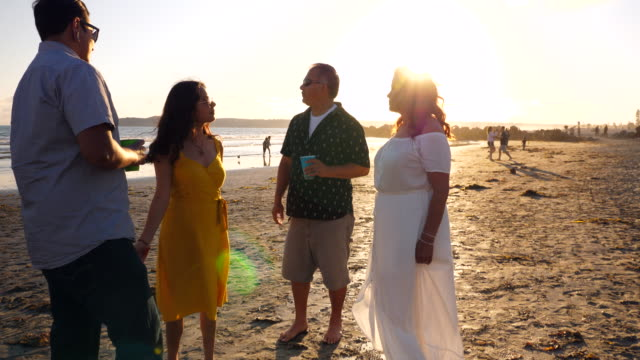ms mature parents hanging out with daughter and her boyfriend during family beach party - pacific islander family stock videos & royalty-free footage
