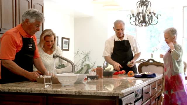 SLOW MOTION - Mature Preparing Food in Kitchen.