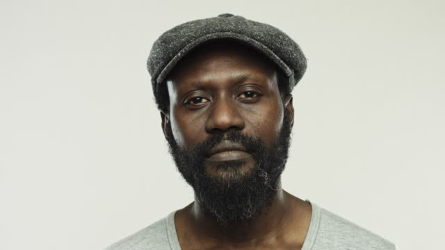 mature real african man with flat cap staring at camera - flat cap stock videos & royalty-free footage