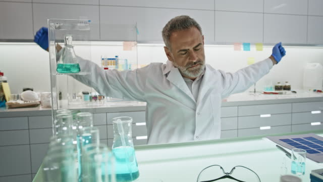 mature scientist in futuristic laboratory. sleeping on the desk and going back to work - biomedical illustration stock videos & royalty-free footage