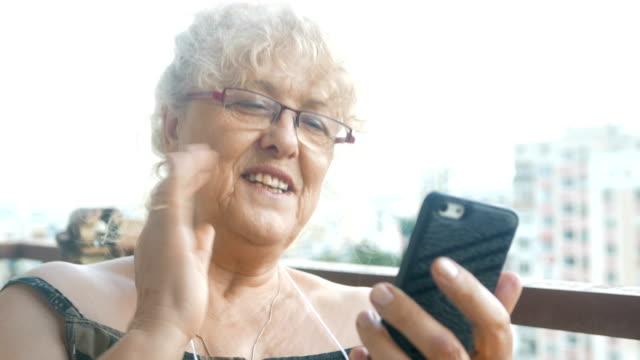 Mature senior woman using her smart phone