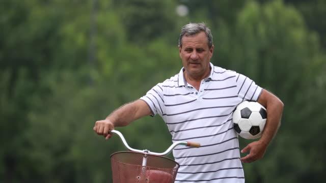Reife Fußballspieler und-Trainer