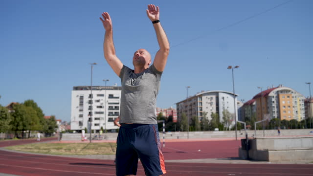 mature sportsman doing jumping jack - star jump stock videos & royalty-free footage