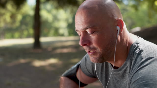 mature sportsman taking a breath after running - tired stock videos & royalty-free footage