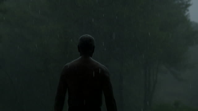 a mature walks out into a rainstorm - poolside stock videos & royalty-free footage