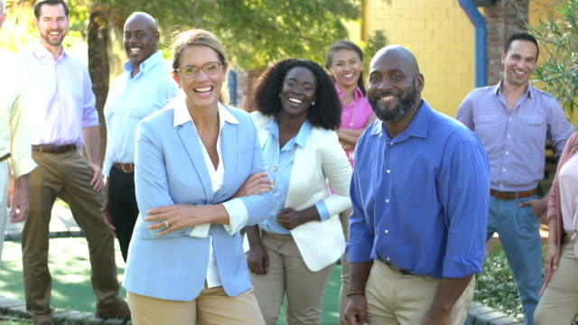 mature woman, african-american man with business team - standing out from the crowd stock videos & royalty-free footage