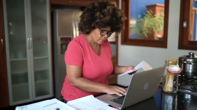 mature woman at home checking finance - electronic banking stock videos & royalty-free footage