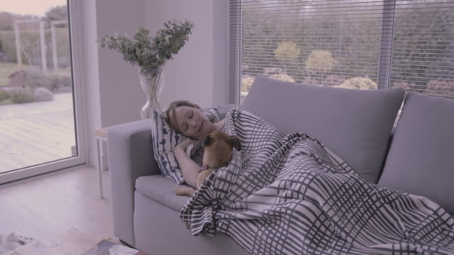 mature woman at home suffering with flue wrapped in a blanket - resting stock videos & royalty-free footage