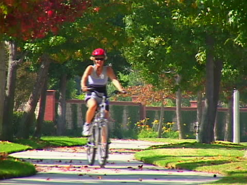 mature woman biking - one mature woman only stock videos & royalty-free footage