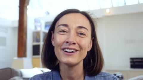 mature woman chatting online - webcam video stock e b–roll