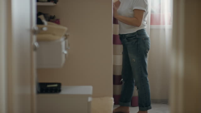 mature woman choosing dress before going out - jeans stock videos & royalty-free footage