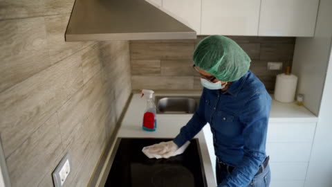 mature woman cleaning kitchen-corona virus protection at home - prevention stock videos & royalty-free footage