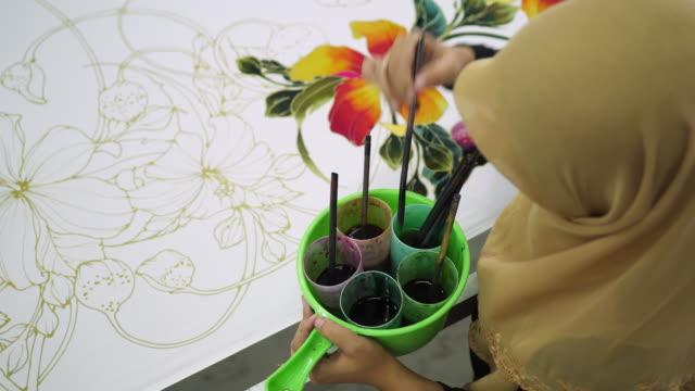 mature woman colouring the batik - batik stock videos and b-roll footage