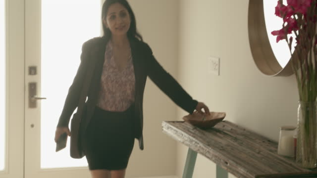 ms mature woman coming home from work - arrival stock-videos und b-roll-filmmaterial