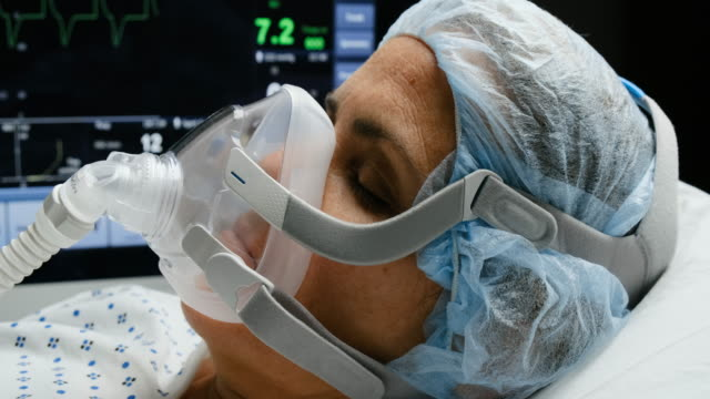 mature woman connected to a ventilator mask - respiratory machine stock videos & royalty-free footage