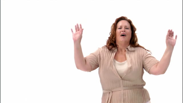 ms, mature woman dancing in studio - pulling funny faces stock videos & royalty-free footage