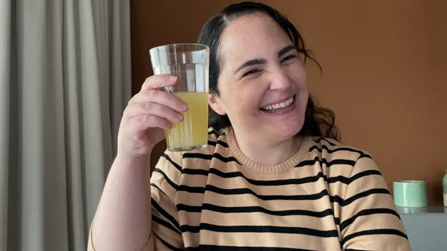 mature woman doing a celebratory toast during virtual happy hour at home - webcam point of view - happy hour stock videos & royalty-free footage