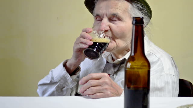 mature woman drink beer - drinking beer stock videos and b-roll footage