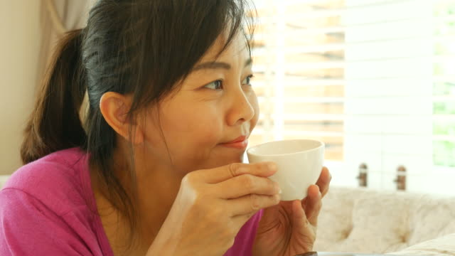 mature woman drink hot tea - teleworking stock videos and b-roll footage
