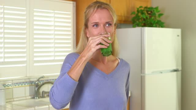 Mature woman drinking fresh juice