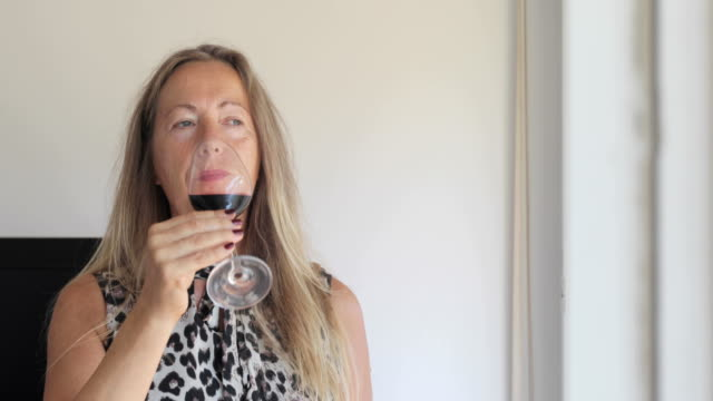 Mature Woman Drinking Red Wine