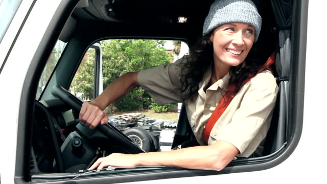 Mature woman driving semi-truck